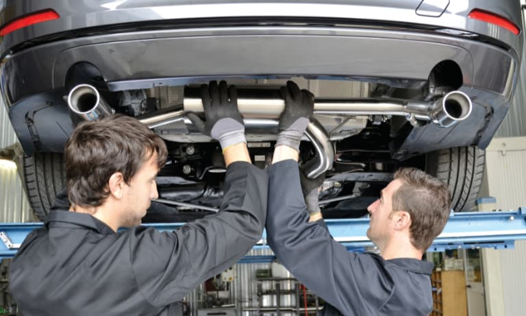 Two Mechanics Replacing a Muffler