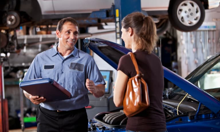 Mechanic Talking to a Female Customer