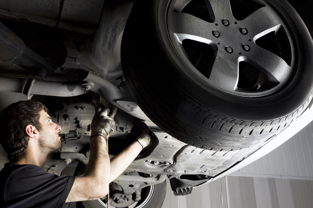 Auto mechanic working on a vehicle