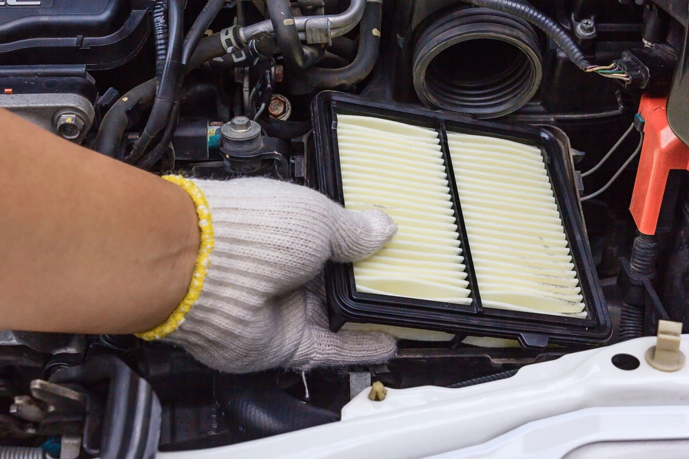 Mechanic replaces an air filter