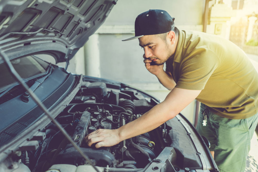 Young man working on his car