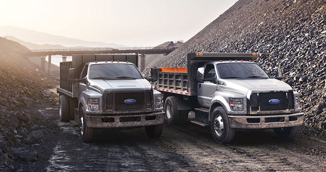 Two Commercial Work Trucks in Quarry