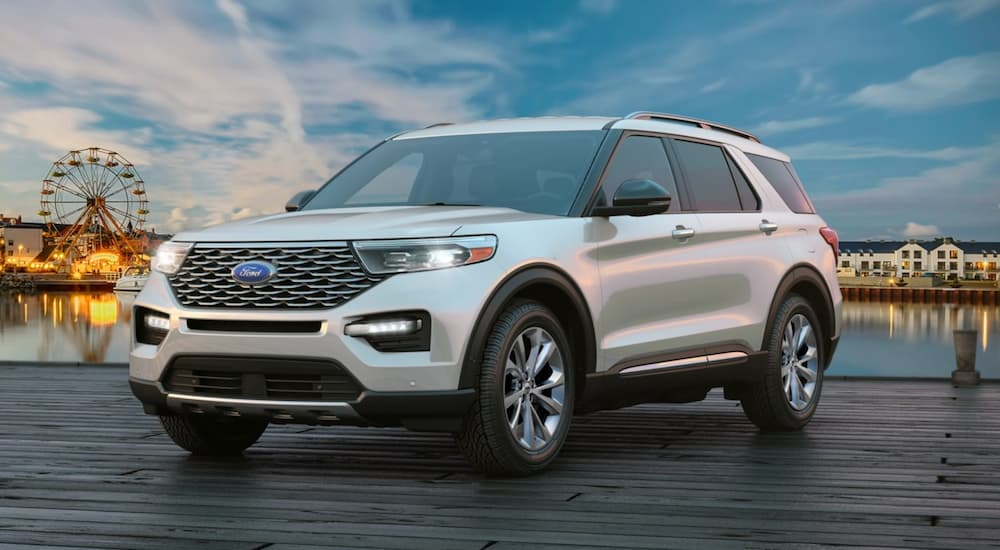 A silver 2021 Ford Explorer Platinum is shown parked on a pier.