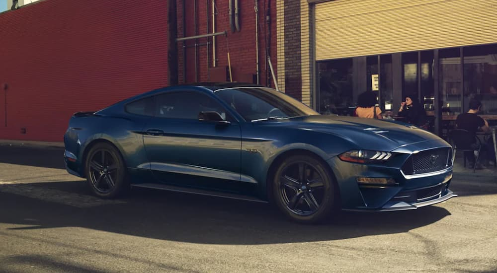 A blue 2021 Ford Mustang Shelby GT500 is shown from the side parked in a city after leaving a Folsom Ford dealership.