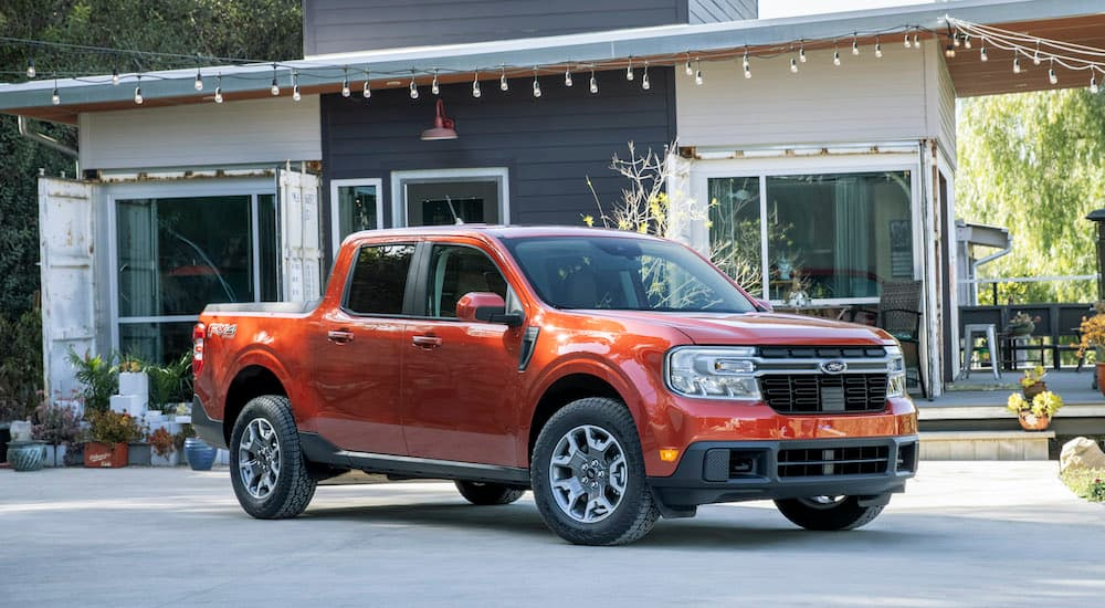 A red 2022 Ford Maverick Lariat is shown in a driveway after leaving a Sacramento Ford dealer.