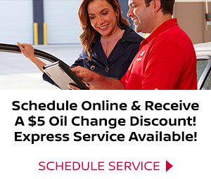 Nissan service advisor gives customer oil change discount for scheduling service online.