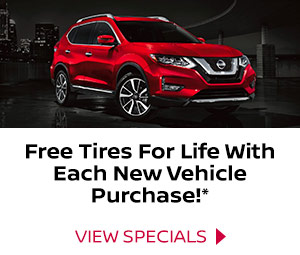 Red Nissan SUV. Free tires for life with each new Nissan purchase.