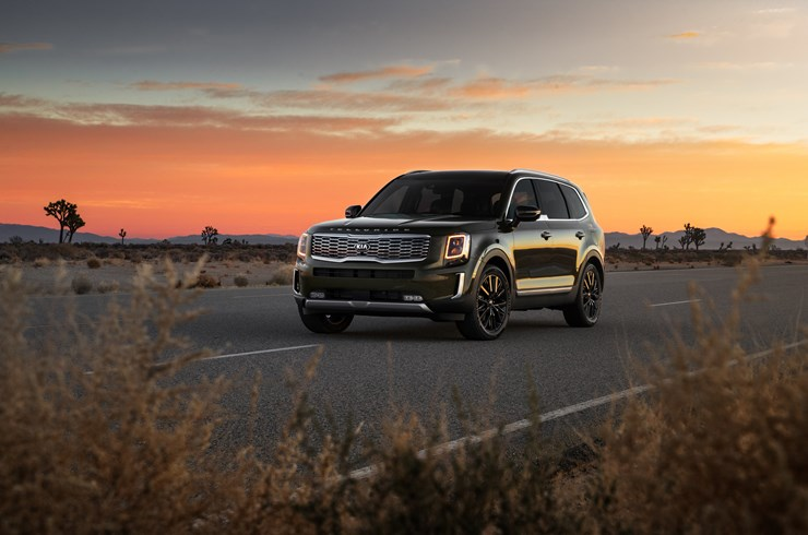 2020 Kia Telluride driving in sunset