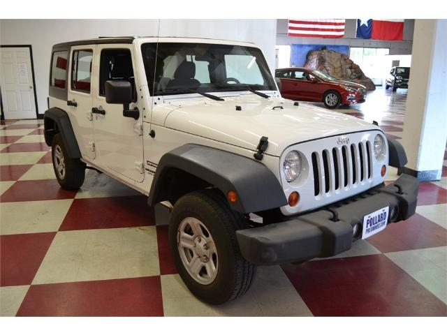 ff5dafcb 2013 Jeep Wrangler Unlimited 4WD 4Dr Sport. pic-14. Stop by this weekend to  pick out your Used Car in Lubbock from Johnathan here at Pollard Pre-Owned!