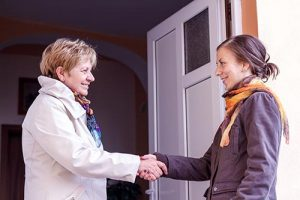 Women Greeting Girl