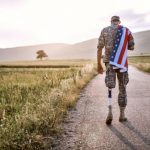 Buy American Independence Sale - Man walking with American flag