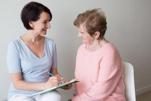 Elderly Female Answering Questions Hand Writing