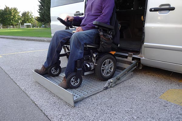 Disabled Man On Wheelchair Going In His Car