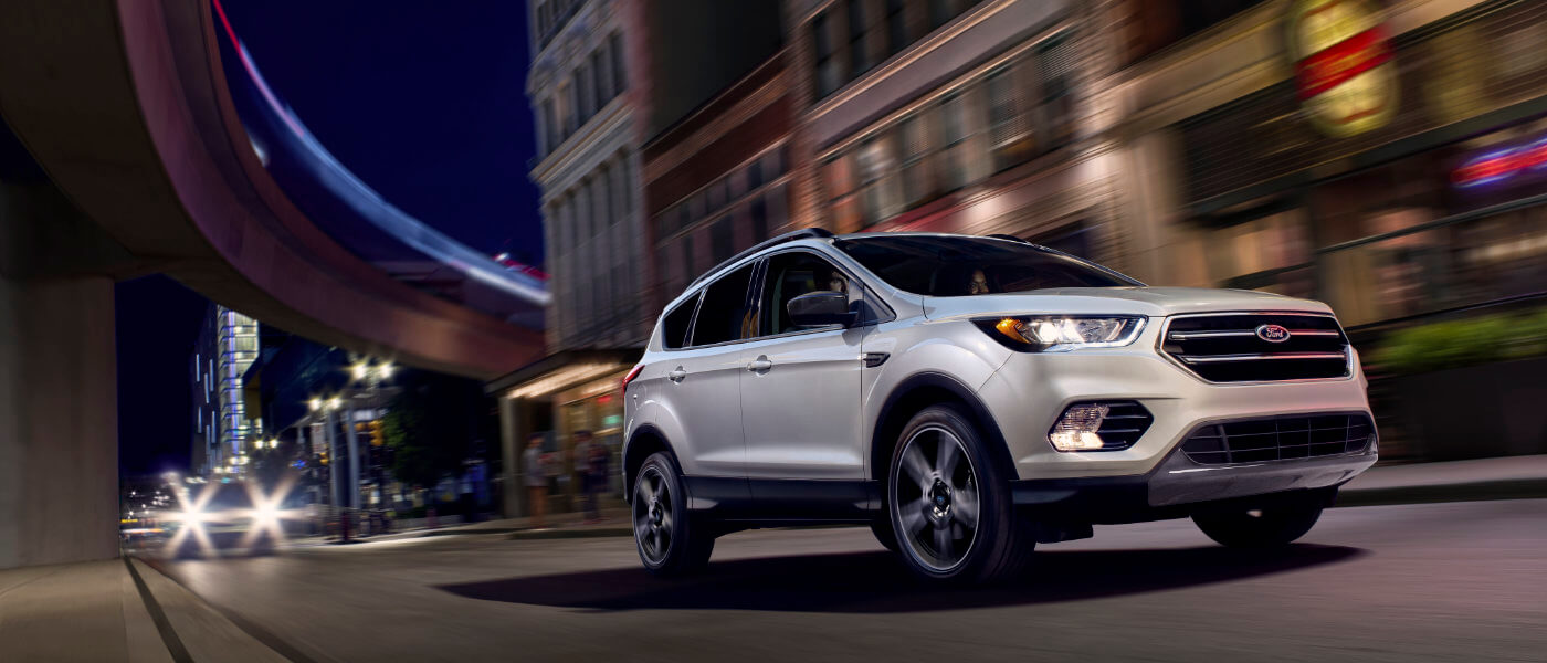 2019 Ford Escape Exterior driving city street at night