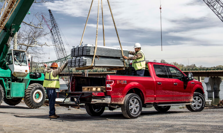 2019 Ford F-150 Crane loading payload onto bed