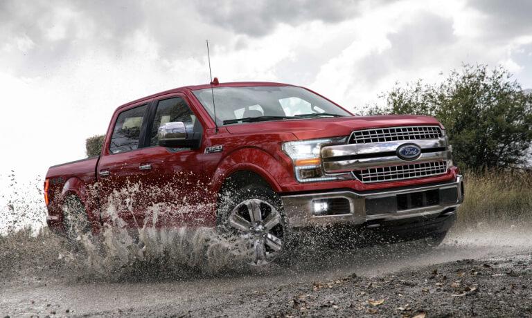 2019 Ford F-150 splashing through mud